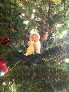This ornament perfectly captures the spirit of Hannah's first Christmas. We welcomed our puppy, Baja, on Christmas eve and she quickly doted on him as this eskimo does to her seal.