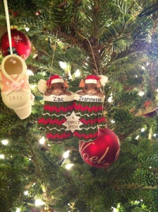 These personalized mice are nestled next to Hannah's first Christmas ornament.