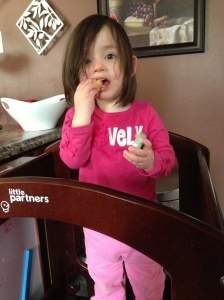toddler eats an apple